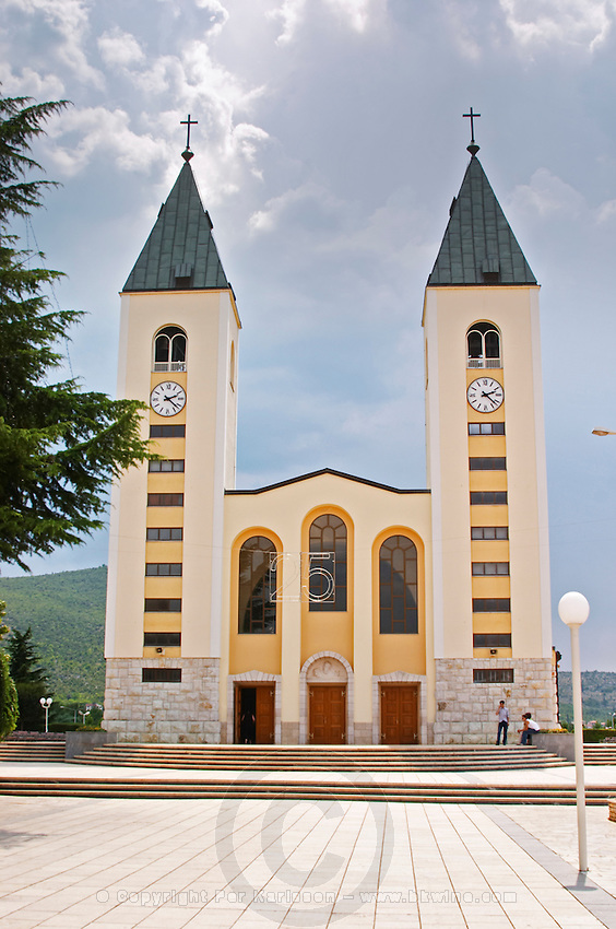 The church with its twin church towers. Medugorje pilgrimage village, near Mostar. Medjugorje. Federation Bosne i Hercegovine. Bosnia Herzegovina, Europe.