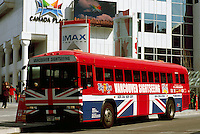 "Sightseeing Tour Bus at ""Canada Place"" Trade and Convention Centre and Cruise Ship Terminal, Vancouver, British Columbia, Canada"