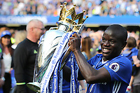 N'Golo Kante of Chelsea proudly holds the Premier League Trophy for the second year in succession after winning the League with Leicester last season during Chelsea vs Sunderland AFC, Premier League Football at Stamford Bridge on 21st May 2017