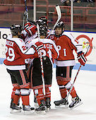 The Engineers celebrate Bryan Brutlag's (RPI - 4) goal which opened scoring in the game. - The visiting Rensselaer Polytechnic Institute Engineers tied their host, the Northeastern University Huskies, 2-2 (OT) on Friday, October 15, 2010, at Matthews Arena in Boston, MA.