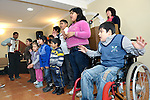"""THIS PHOTO IS AVAILABLE AS A PRINT OR FOR PERSONAL USE. CLICK ON """"ADD TO CART"""" TO SEE PRICING OPTIONS.   A children's choir, including a boy in a wheel chair, sings during a worship service of the United Methodist Roma congregation in Jabuka, Serbia.."""