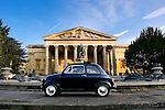 Early morning (sunrise) photograph of an original Fiat 500 outside the Victoria Rooms in Clifton Bristol.