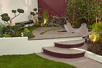 Tiered Patio, garden bench, wall, modern plantings, lights for evening enjoyment