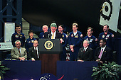 United States President Bill Clinton (at lectern) addresses employees at NASA's Johnson Space Center (JSC) during an April 14, 1998 visit to the Houston facility. Seated behind him (from the left) are JSC Director George W.S. Abbey, U.S. Representative Nick Lampson (Democrat of Texas), NASA Administrator Daniel Goldin and Houston Mayor Lee Brown. Standing are members of the STS-95 crew: (from the left) Pedro Duque, Chiaki Mukai, U.S. Senator John H. Glenn Jr. (Democrat of Ohio), Stephen K. Robinson, Scott E. Parazynski, Steven W. Lindsey and Curtis L. Brown Jr. Brown is commander of the scheduled flight aboard Discovery. Mukai represents Japan's National Space Development Agency (NASDA) and Duque is with the European Space Agency (ESA). .Credit: NASA via CNP