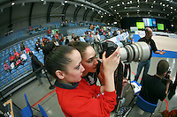 (L-R) Isabel Pagán and Bárbara Gonzáles of Spain's senior rhythmic group check the pictures in photographer Esther Teijeira's camera at 2007 Portimao World Cup of Rhythmic Gymnastics on April 28, 2007 at Portimao, Portugal.  (Photo by Tom Theobald).Photo note: Thanks to Guillermo for correct id's of gymnasts.