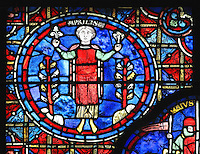 Personification of the beginning of Spring by a man between 2 flowering trees, holding one blooming flower and one wilted flower, section of April from the Zodiac and the labours of the months stained glass window, 1217, in the ambulatory of Chartres Cathedral, Eure-et-Loir, France. This calendar window contains scenes showing the zodiacal symbol with its corresponding monthly activity. Chartres cathedral was built 1194-1250 and is a fine example of Gothic architecture. Most of its windows date from 1205-40 although a few earlier 12th century examples are also intact. It was declared a UNESCO World Heritage Site in 1979. Picture by Manuel Cohen
