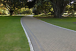 Brick walking path winding through the Christchurch Botanic Gardens, Christchurch, New Zealand