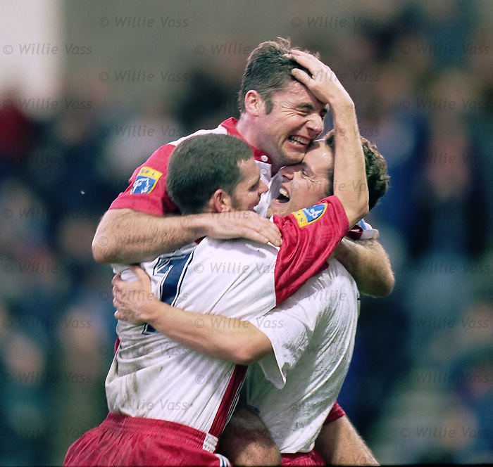 Ally McCoist celebreates scoring with Ian Durrant and Alec Cleland in November 1996