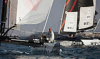 Extreme Sailing Series 2011. Leg 1. Muscat. Oman.Day 5 of racing.   Picture showing Alinghi skippered by Tanguy Cariou