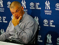 Manager Joe Girardi #28 of the New York Yankees speaks during a press conference following Derek Jeter's final career game against the Boston Red Sox at Fenway Park on September 27, 2014 in Boston, Massachusetts. (Photo by Jared Wickerham for the New York Daily News)