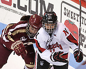 Dana Trivigno (BC - 8), Rachel Llanes (NU - 11) - The Northeastern University Huskies defeated Boston College Eagles 4-3 to repeat as Beanpot champions on Tuesday, February 12, 2013, at Matthews Arena in Boston, Massachusetts.