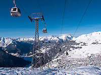 Switzerland. Canton Valais. Verbier is a village located in the municipality of Bagnes. The village lies on a south orientated terrace at around 1,500 metres facing the Grand Combin massif. The terrace lies on the east side of the Val de Bagnes. Verbier had 3000 permanent residents in 2010. The number of residents can rise to 35,000 in the winter season. Verbier is one of the largest holiday resort and ski areas in the Swiss Alps, 3.01.2012 © 2012 Didier Ruef
