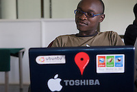 """A software engineer at John Gosiers' startup """"Appfrica"""". A recent graduate of Makerere Universitites' Computer Science department, is a convert to Open Source Software. Western software tools such a Microsoft servers are disproportionaly expensive compared with people and hardware costs in Africa. The price of bandwidth, more expensive than in developed markets also puts Ugandan's at a disadvantage: """"We have to use Google like everyone else, to read documentation, to write code"""". Ambition is one thing not lacking: """"We're going to be like India in 10 years. We're going to get those contracts""""."""