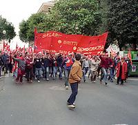Roma Maggio 2004.Manifestazione degli operai della Fiat di Melfi.Gli Striscioni dei sindacati, Fiom CGIL .Demonstration of workers at Fiat Melfi .The banners salary, rights, democracy,