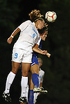 24 September 2009: North Carolina's Whitney Engen (9) and Duke's KayAnne Gummersall (behind) challenge for a header. The University of North Carolina Tar Heels defeated the Duke University Blue Devils 2-1 in sudden victory overtime at Fetzer Field in Chapel Hill, North Carolina in an NCAA Division I Women's college soccer game.