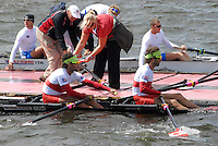 Hamilton, New Zealand, 2010  World Rowing Championships, Lake Karapiro Sunday  31/10/2010.  CAN LM2X, come to Pontoon, assisted by Coach, Mike SPRACKLEN, after nearly sinking,  after racing suspended due to bad weather [Mandatory Credit Karon Phillips/Intersport Images]