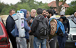 Serbian taxi drivers negotiate with immigrants outside a refugee processing center in the Serbian village of Presevo, not far from the Macedonian border. Hundreds of thousands of refugees and migrants have flowed through Serbia in 2015, on their way from Syria, Iraq and other countries to western Europe. Taxi drivers have been criticized for taking advantage of the refugees by charging exorbitant fares.