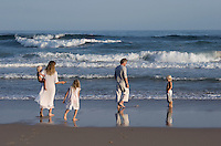 Trevyn McGowan and her family enjoy a stroll along the shoreline of the beach by their home