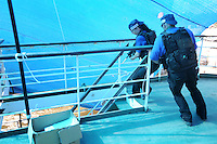 Trainees take part in a training course to fight maritime terror and piracy, on a boat in Haifa Port...