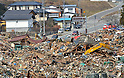 April 2nd, 2011, Rikuzentakata, Japan - Heavy machines work in the mountain of debris in Rikuzentakata City, Iwate Prefecture, on April 2, 2011, three weeks after this Japanese coastal city was wiped out by a tsunami that followed a magnitude 9.0 earthquake. Rikuzentakata was one of the worst-hit town in the entire northeastern region. (Natsuki Sakai/AFLO) [3615] -mis-...