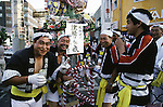 Nebuta Parade participants fortifie thmselves with beer and sake before the start of the parade in Aomori, Japan.  Huge illuminated paper-mache floats made of lumber, bamboo, wire and paper depicting men, animals and birds are pushed and pulled through the streets by groups of men, women and children during the Nebuta Festival in Aomori, Japan.  The festival dates back to the beginning of the eight century when the Ezo residents in northern Honshu rose in revolt. The Emperor sent General Sakanoue-no-Tamramaro, who, built Nebuta dummies of men and horses which were floated away at night. The Ezo thinking the Imperial troops had withdrawn, came back into the city only to be slaughtered by troops waiting in secret. Themes of the floats are picked from Kabuki stages, historical characters or fairy tales. (Jim Bryant Photo).....