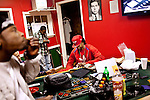 Atlanta rapper Tity Boi, aka 2 Chainz, chills at the Duffle Bag Studio with friends in College Park, Georgia March 1, 2011. ..(Tity Boi is in the all red jumpsuit and red hat).
