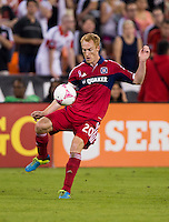 Jeff Larentowicz (20) of the Chicago Fire punts the ball forward during a Major League Soccer game at RFK Stadium in Washington, DC.  The Chicago Fire defeated D.C. United, 3-0.
