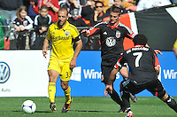 Federico Higuain (33) of the Columbus Crew controls the ball against Perry Kitchen (23) of D.C. United. The Columbus Crew defeated D.C. United 2-1 ,at RFK Stadium, Saturday March 23,2013.