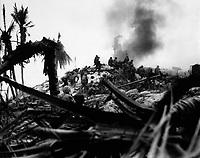 Marines storm Tarawa.  Gilbert Islands.  November 1943. WO Obie Newcomb, Jr. (Marine Corps)<br /> Exact Date Shot Unknown<br /> NARA FILE #:  127-N-63458<br /> WAR &amp; CONFLICT BOOK #:  1179