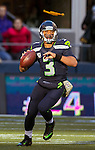 Seattle Seahawks quarterback Russell Wilson passes against the  Minnesota Vikings at CenturyLink Field in Seattle, Washington on  November 17, 2013. Wilson ran for 54 yards and passed for  two touchdowns in Seahawks 41-20 win over the Vikings.  ©2013.  Jim Bryant. All Rights Reserved.