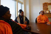 "Cease Fire outreach workers and violence interrupters (l-r) James Sima, 39, supervisor Ulysses ""US"" Floyd, and Jerusha ""Rue"" Hodge, 42, briefing in their office on recent developments in the neighborhoods where they work with at risk youth participants on the far South Side of Chicago, Illinois on February 3, 2017.  Cease Fire is a public health initiative that attempts to stop or halt gun violence across the city."