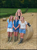 BNPS.co.uk (01202 558833)<br /> Pic: PhilYeomans/BNPS<br /> <br /> L-r Harriet (25), Carol (52), Katy (21) (top) and Georgina (28).<br /> <br /> Far from the Madding Crowd - Land Girls...Plucky mum and her daughters running the family farm in the heart of Dorset.<br /> <br /> Widow Carol Besent is getting a bumper harvest in this year with the help of her three daughters Georgina, Harriet and Katy.<br /> <br /> Carol's husband died four years ago and rather than give up the family farm Carol and her daughters have taken the unusual step of running the 700 acre mixed arable and dairy farm themselves.