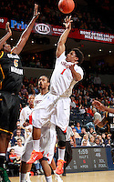 CHARLOTTESVILLE, VA- DECEMBER 6: Jontel Evans #1 of the Virginia Cavaliers shoots in front of Jonathan Arledge #5 of the George Mason Patriots during the game on December 6, 2011 at the John Paul Jones Arena in Charlottesville, Virginia. Virginia defeated George Mason 68-48. (Photo by Andrew Shurtleff/Getty Images) *** Local Caption *** Jonathan Arledge;Jontel Evans