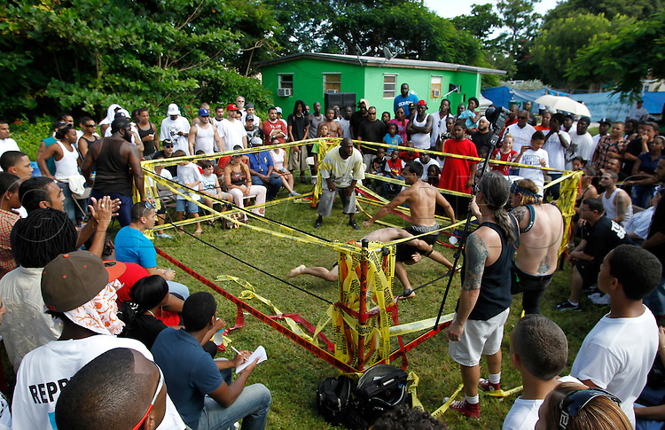"The ring as it looks on September 18, 2010. Dhafir Harris, ""Dada 5000"", puts on backyard fights at his mother house, which go viral on youtube and have been the subject of documentaries. Sometimes the men fight until they are unconscious. There' s no gloves and occasionally, there's a cage. The community has taken to the events, because they are able to set up businesses selling food and washing cars."
