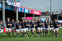 The Scotland team jog around the pitch during the pre-match warm-up. Rugby World Cup Pool B match between Scotland and Japan on September 23, 2015 at Kingsholm Stadium in Gloucester, England. Photo by: Patrick Khachfe / Onside Images