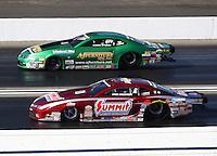 Nov 13, 2016; Pomona, CA, USA; NHRA pro stock driver Greg Anderson (near) alongside Aaron Strong during the Auto Club Finals at Auto Club Raceway at Pomona. Mandatory Credit: Mark J. Rebilas-USA TODAY Sports