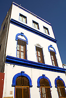 Blue and white facade of a restored nineteenth century building in old Mazatlan, Sinaloa, Mexico