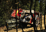SPAIN, Vegas de Coria : A damaged fire engine and a car are pictured after colliding following raging wildfire in Vegas de Coria, near Caceres, on July 28, 2009. (C) Pedro ARMESTRE
