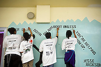 Students paint a mural against hate at a middle school in the borough of Brooklyn in New York on Sunday, March 25, 2012.  The mural was part of the Anti-Defamation League No Place for Hate program.  (© Frances M. Roberts)