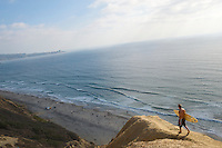 Surfer walking the Goat Trail - Blacks Beach - La Jolla - California