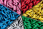 Container of multicolored paper clips