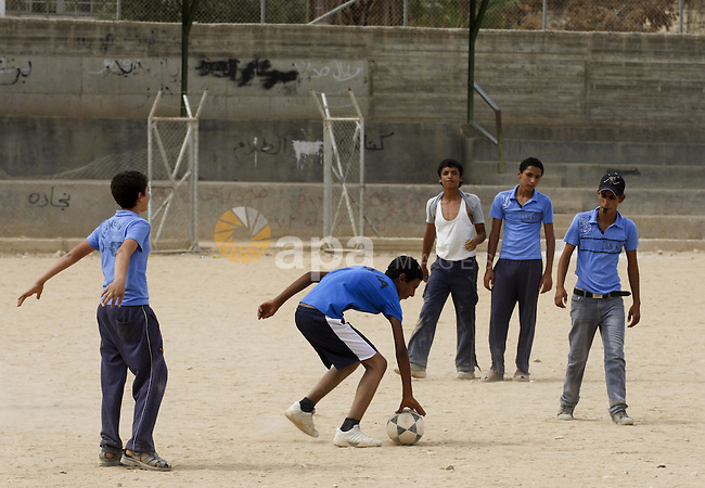 Palestinian boys play football , in West Bank city of Jericho , on Oct. 11.2010 . Jericho is one of the oldest continuously inhabited cities in the world, with evidence of settlement dating back to 9000 BC,it has a population of over 20,000 Palestinians. Situated well below sea level on an east-west route 16 kilometres (10 mi) north of the Dead Sea, Jericho is the lowest permanently inhabited site on earth . Photo by Eyad Jadallah