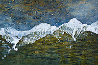 &quot;KOOTENAY ROCKIES&quot;<br /> <br /> The snow capped Kootenay Rocky Mountains and forest in early spring  reflected on Norris Lake in British Columbia, Canada. The sky and foothills are mottled by the rocky lake bed.<br /> <br /> The original giclee on canvas is currently on loan to the Kalispell Regional Medical Center ORIGINAL <br /> <br /> 24 X 36 GALLERY WRAPPED CANVAS SIGNED BY THE ARTIST $2,500. CONTACT FOR AVAILABILITY.