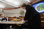 Jan Pepper signs paperwork during her swearing-in ceremony at the Los Altos city council Dec. 4.