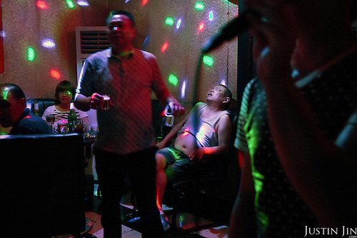 A farmer until one year ago, a man slumps into his chair during a karaoke session in a bar in southern China in her newly furnished apartment given by the government in return for seized land.<br /> <br /> China is pushing ahead with a dramatic, history-making plan to move 100 million rural residents into towns and cities over six years &mdash; but without a clear idea of how to pay for the gargantuan undertaking or whether the farmers involved want to move.<br /> <br /> Moving farmers to urban areas is touted as a way of changing China&rsquo;s economic structure, with growth based on domestic demand for products instead of exporting them. In theory, new urbanites mean vast new opportunities for construction firms, public transportation, utilities and appliance makers, and a break from the cycle of farmers consuming only what they produce.<br /> <br /> Urbanization has already proven to be one of the most wrenching changes in China&rsquo;s 35 years of economic reforms. Land disputes rising from urbanization account for tens of thousands of protests each year.
