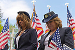 Merrick, New York, U.S. - May 26, 2014 - L-R, MARGARET BIEGELMAN and DEBRA BERNHARDT, members of the Merrick American Legion Auxiliary Post 1282, participate in The Merrick Memorial Day Parade and Ceremony. They bowed their heads during a Moment of Silence, for those who died in war while serving in the United States military.