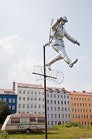 Sculpture recreating the famous photograph of an East German border guard jumping to freedom over the Berlin Wall in its early days of construction when it was little more than a barbed wire fence. This is near the exact spot on Bernauer Strasse where the photo was taken and where many desperate scenes took place in 1961 as people jumped from the windows of their houses that stood on the edge of the Wall into West Germany. The green area is the former &quot;death strip&quot; that was created on the eastern side of the Wall once it was erected making it more difficult to escape to the West.