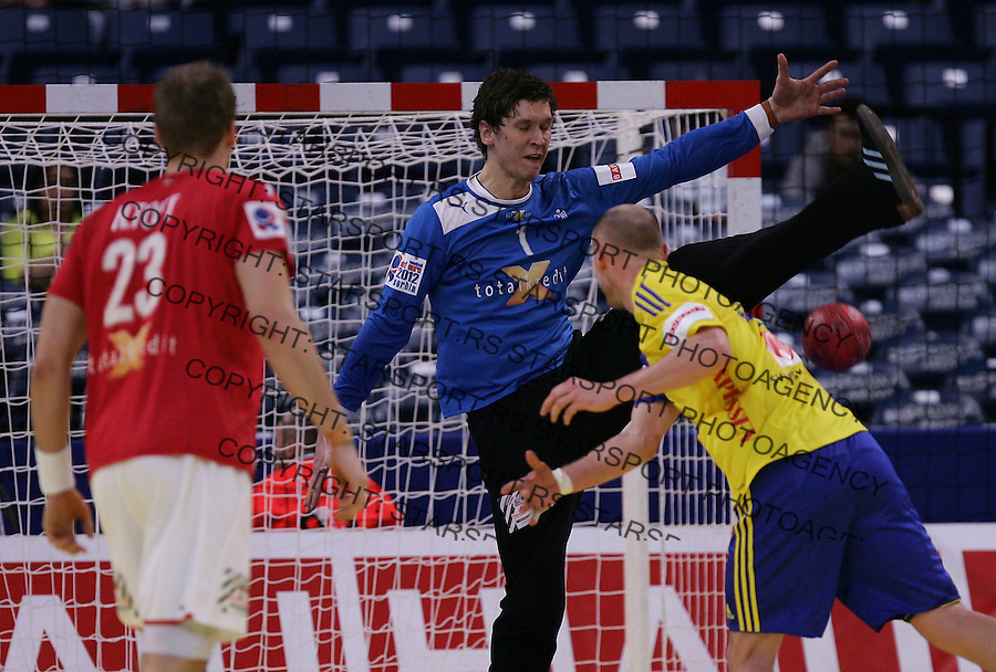 BELGRADE, SERBIA - JANUARY 25: Goalkeeper Niklas Landin Jacobsen (C) of Denamrk saves the penalty shot of  Henrik Lundstrom (R) of Sweden during the Men's European Handball Championship 2012 second round  group one, match between Denmark and Sweden at Arena Hall on January 25, 2012 in Belgrade, Serbia. (Photo by Srdjan Stevanovic/Starsportphoto.com ©)