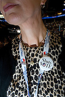 """CHARLOTTE, NC - September 6, 2012 - A Illinois delegate modals a """"Slut,"""" pin made as a response to Rush Limbaugh calling Sandra Fluke a prostitute for her saying health insurance should cover contraception."""