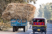 Nearly every truck in India has the sign Blow Horn! So a typically overloaded tuk tuk obliges while overtaking on the road from Delhi to Agra.<br /> (Photo by Matt Considine - Images of Asia Collection)
